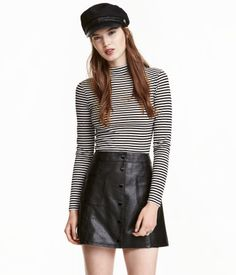 Black/white striped. Short top in soft, ribbed jersey with a mock turtleneck and…