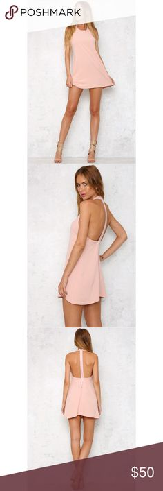 Hello Molly So Kendall Dress in Blush size Medium Say goodbye to wardrobe dilemmas with the So Kendall Dress! This gorgeous style is made from a super soft, light weight fabric. With a round high neckline and a low cut away back. There is an exposed silver metal zipper running through the back. We love adding a bright splash of colour when styling ours - think fuchsia or flame red pumps and lips!  Dress. Not lined. Slightly sheer. Cold hand wash only. Model is standard S and is wearing S…