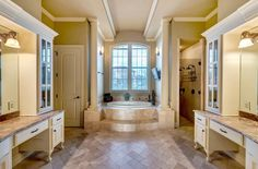 Thumbs way up for this master bathroom // Dual vanities, natural light, columns, crown molding, tub under the window, dual shower heads