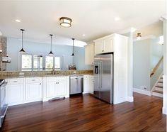 White kitchen with dark wood floors #kitcheninspiration