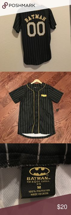 Men's Batman  baseball style  jersey top Black and gold button front jersey Batman with double zeros on the back Batman emblem on the front pinstripe no stains no damage no snags in great condition no stretch 100% polyester machine washable Shirts Tees - Short Sleeve