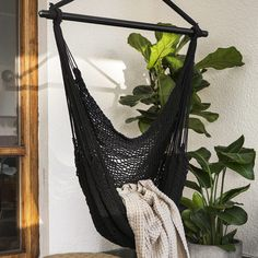Cosy hanging chair at the balcony.