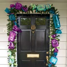 DIY Clamshell Candy Chain - FamilyFun reader Hallie Lowe of Cedar Park, Texas, sweetens her home's front entry with a string of super-sized treats, cleverly constructed from take-out containers  colorful cellophane wrap!