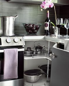 HGTVRemodels shows you a kitchen makeover that uses gray in the cabinetry, flooring and backsplash.