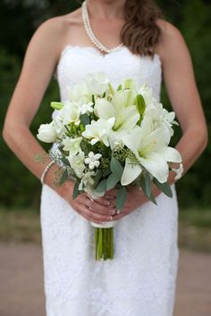 white lilies eucalyptus wedding flower bouquet, bridal bouquet, wedding flowers, add pic source on comment and we will update it. www.myfloweraffair.com can create this beautiful wedding flower look.
