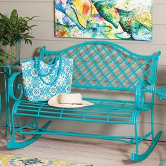 Turquoise metal rocking bench with a lattice band and scrolling arms.  Product: Rocking benchConstruction Material: ...