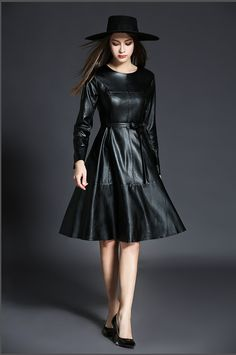 Flared or A- line, VERY pretty leather dress.