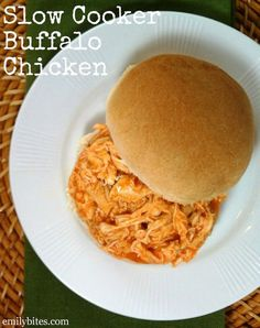 Slow Cooker Buffalo Chicken - just four ingredients and no prep! Easy and delicious for just 175 calories or 3 Weight Watchers SmartPoints per serving. www.emilybites.com