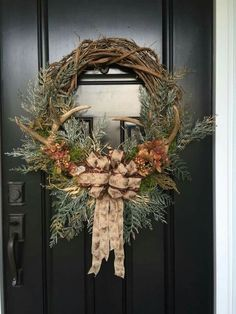 Ooohh, need this minus the bow! Rustic fall or winter wreath with antlers in a grape vine wreath with Green pines.and deer ribbon bow Fall Crafts, Holiday Crafts, Holiday Decor, Holiday Wreaths, Christmas Decorations, Winter Wreaths, Christmas Centerpieces, Antler Wreath, Hunting Wreath