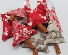 Scandi fabric Christmas tree decorations available in 3 designs, red with moose head, red Christmas hearts and beige nordic design. These gorgeous Christmas trees are stuffed with cloves (and wadding for shape) and finished with a cinnamon stick trunk. They smell like Christmas and