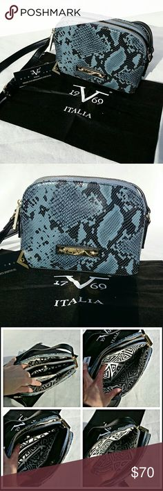 **SALE** Versace 1969 Blue Snake Crossbody BRAND NEW! NWT! Versace 1969 Blue Snake Josephine Crossbody! *not real snake skin* 3 separate compartments. 2 outer zip closed & inner has a magnetic snap closure. Inner compartment has an inner small zippered pocket. Holds a lot for a small bag! Black & white geometric interior! Adjustable strap. Gold tone hardware. *Includes dust bag* *REASONABLE* offers considered...10% discount when bundled Versace Bags Crossbody Bags