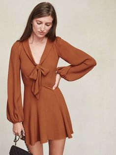 The Rosetta Dress makes us think of Brigitte Bardot strutting around in the 70s and looking super French. https://www.thereformation.com/products/rosetta-dress-cognac?utm_source=pinterest&utm_medium=organic&utm_campaign=PinterestOwnedPins
