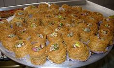Konafa, an Egyptian dessert made of thin pastry strands, nuts, and sweet syrup