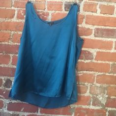 """Talbots 100% silk Sz 16 petite teal blouse • Brand: Talbots • Type: Blouse • Size: 16petite • Fabric: 100% Silk • Condition: Excellent Used Condition! • Color: Teal • Measurements: Bust – 22"""" across the front, lying flat. Length - 24"""" from shoulder to hem. ⬆ ️Measurements & info ⬆️ ✅ YES - Offers, bundles, questions ✅  NO - Trades, holds, PP  ⭐️ All items are authentic ⭐️ Talbots Tops Blouses"""