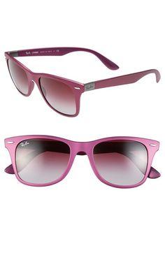 Pretty pink Ray-Ban sunglasses.