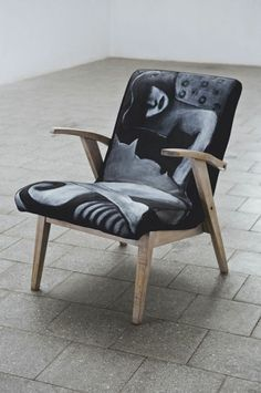 Armchair from the 60s. Old layers of paint have been completely removed exposing raw wood. Woodwork covered with hard oil wax and colored - that highlights the structure of wood and gives it a white glow. The upholstery is made of natural  black linen decorated with a painting. Author of the painting: Katarzyna Tchórz.