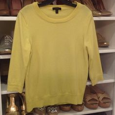 J.Crew yellow Tippi sweater Size Large but a little shrunken after hand washing in cold water.  Would fit M/L.  So cute with navy, gray, or black.  Perfect transition to spring.  Great condition. J. Crew Sweaters Crew & Scoop Necks
