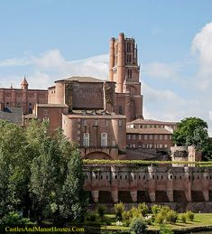 """Albi, Tarn, France... www.catharcountry.info ... This is a view of the Cathédrale Sainte-Cécile with the Palais de la Berbie (""""Palace of the Bishop"""") in front of it. Both were built by an Inquisitor-Bishop of Albi in the thirteenth century to emphasize the recent victory of the French Catholic Crusade over the indigenous population. The whole complex was built inside a defensible walled episcopal city, the locals being hostile, and still sympathetic to the Cathar cause."""