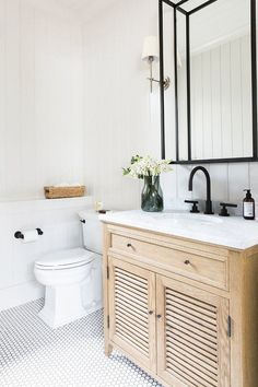 Neutral farmhouse bathroom with vertical shiplap, hex floor tile and Black metal mirror. Studio McGee. Home Bunch Blog