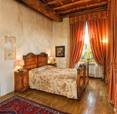 Love the floor, wall, bed...no so much the draperies, bedspread.