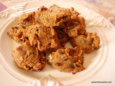 Pumpkin Honey Cookies--2 ¼ cups almond flour  1 teaspoon pumpkin pie spice (or more to taste)  1 ½ teaspoon baking powder  1 teaspoon baking soda  1/2 teaspoon salt  3/4 cup honey  1 – 2 tsp coconut oil, liquefied (optional, or equal amount of extra virgin olive oil)  1 cup pumpkin purée  1 large egg  1 cup chopped pecans  1 cup chocolate chips (optional; I used Enjoy Life mini chocolate chips)
