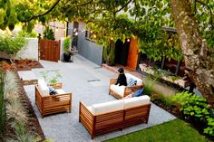 Looking for Outdoor Space and Courtyard ideas? Browse Outdoor Space and Courtyard images for decor, layout, furniture, and storage inspiration from HGTV. Modern Courtyard, Modern Backyard, Courtyard Ideas, Front Courtyard, Pergola Ideas, Backyard Ideas, Garden Ideas, Outdoor Wood Furniture, Outdoor Flooring