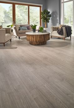 Highly water-resistant Misty Morning Oak is the perfect laminate floor for those who want a coastal style. Its varying neutral shades help accentuate the authentic hardwood design. Flooring, Coastal Living Rooms, Decor, Waterproof Laminate Flooring, Laminate Flooring Colors, Laminate Wood Flooring Colors, Laminate Plank Flooring, Floor Design