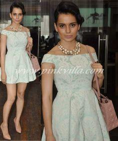 Kangana Ranaut in a blue brocade Topshop dress with Dior bag and nude pumps.