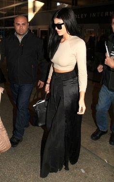 kylie jenner black panel belt skirt beige crop top airport
