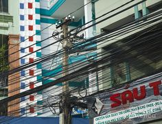 Utility Pole In Saigonho Chi Minh City, Vietnam Photograph  - Utility Pole In Saigonho Chi Minh City, Vietnam Fine Art Print