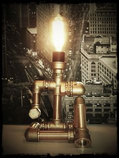 Sitting man industrial table lamb made of 100% brass fittings and brass pipes with a e27 vintage lamp