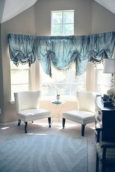 Bay window drapes can help spice up those odd spaces in your home. This one is really unique ! Call Budget Blinds today for a free in home consultation !