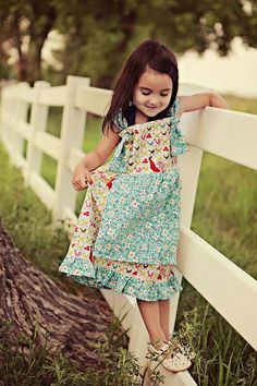 YaYa would TOTALLY love this dress!  Notice the chicken print on the bodice and skirt?