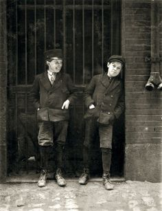 "May 1910. St. Louis, Mo. ""Two boys working in Inland Type Foundry, 12th & Locust. Work 9 to 10 hours a day. Noon."" Photo by Lewis Hine. -kids are still kids-"