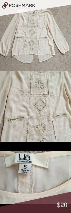 Ya lots Angeles sheer embroidered top Such a beautiful top featuring embroidery detailing in the front and a peep open back. The material is sheer and flowy. Size small. Considering reasonable offers!! Ya Los Angeles Tops Blouses