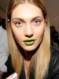 Wearing a lime lipstick.