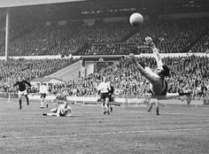 15th April 1967. England goalkeeper Gordon Banks saves a shot from Scotland's Denis Law in the Home International fixture at Wembley,