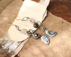Hey, I found this really awesome Etsy listing at https://www.etsy.com/listing/188931926/raw-pale-pink-gemstone-dangle-assemblage