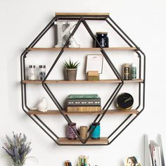 Rustic farmhouse design meets functionality with this floating octagon shelving. Constructed of a metal frame with 5 solid wood shelves, this floating shelving can be used to display your books, photo frame Solid Wood Shelves, Wood Floating Shelves, Wood Wall Shelf, Glass Shelves, Display Shelves, Decorative Wall Shelves, Circle Wall Shelf, Cool Shelves, Wall Shelf Decor