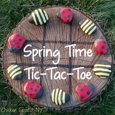 Spring Time Tic Tac Toe - other ideas > use a round or square cutting board / picture frame w/out glass, paint back board, line, put back in frame /// use magnetic paint, glue magnet on back of rock /// rocks can be painted to match decor of any room or fav colors///adjust rock size to board.  nice to set on porch.