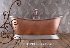 Our Copper Bateau with a polished Nickel plinth & interior, a truly stunning bath, and the copper exterior contrasts beautifully with the Nickel plinth and interior.   As copper conducts heat, your bath water will stay warmer for much longer, meaning you can spend more time relaxing!  #copper #bath #bathroom #copperbath #nickel #metallic #decor #home