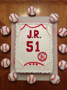 Every newborn has a onesi.  So why not a cake for the baby shower.  This cake is surrounded with cupcakes decorated to look like baseballs.  The Boston Red Sox logo in the right hand corner and decorated in the teams colors.