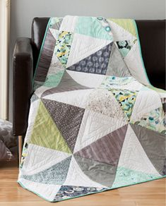 This modern quilt pattern featured in Quilty September/October features hourglass quilt blocks that combine to create a modern quilt. Big lawns, driveways, neighborhood bake sales, and this quilt. Quilt by AGF Design Team.
