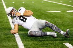 Quarterback Marcus Mariota #8 of the Oregon Ducks lays on the ground after a play in the fourth quarter against the Ohio State Buckeyes during the College Football Playoff National Championship Game at AT&T Stadium on January 12, 2015 in Arlington, Texas. (Jan. 11, 2015 - Source: Kevin C. Cox/Getty Images North America)