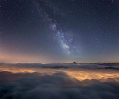The Milky Way's galactic center appears above a sea of clouds in this photograph by Roberto Bertero, who trekked to a remote mountain top to capture the image. He stayed overnight at the summit of Mount Rocciamelone, watching in awe as the sky changed above the Italian Alps.