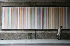 """Ian Davenport: """"Poured Lines: Southwark St,"""" 200g. Davenport likes to explore what paint can do, particularly when it comes to pouring it down a canvas. This piece can be seen along 48 metres of Southwark Street in London, near Tate Modern. It's a rare example of painting as curated public art."""