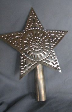 Rustic Handmade Punched Tin Christmas Tree Star Topper. I want one of these for my tree but in brown color! Metal Christmas Tree, Creative Christmas Trees, Christmas Tree Star Topper, Christmas Star, Primitive Christmas, Country Christmas, Handmade Christmas, Christmas Ornaments, Xmas Tree