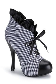 Features: Houndstooth fabric, rounded toe front, ruffle cuff, lace up, and 4 inch heels.