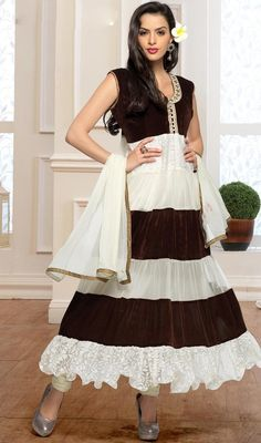Augment your charming persona clad in this off white and brown color velvet net Anarkali suit. That you can see some interesting patterns done with lace and resham work. #anarkalisuitsonline #newdesignanarkalidress #anarkalidresses