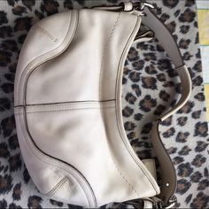Coach purse ..Cream color ..too small for me!! Cream color perfect summer purse for parties!! Coach Bags Clutches & Wristlets